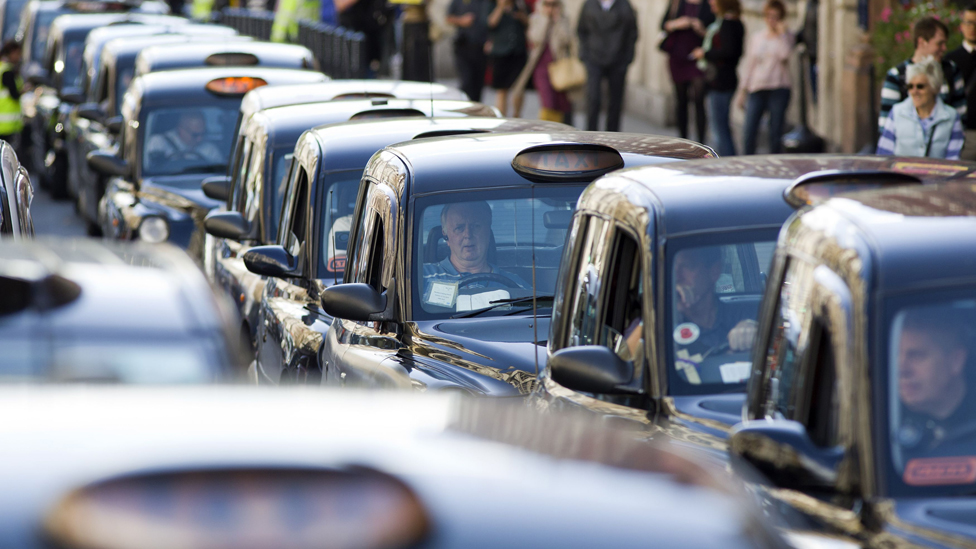 London taxi drivers block Whitehall during a slow driving protest in central London, 2014