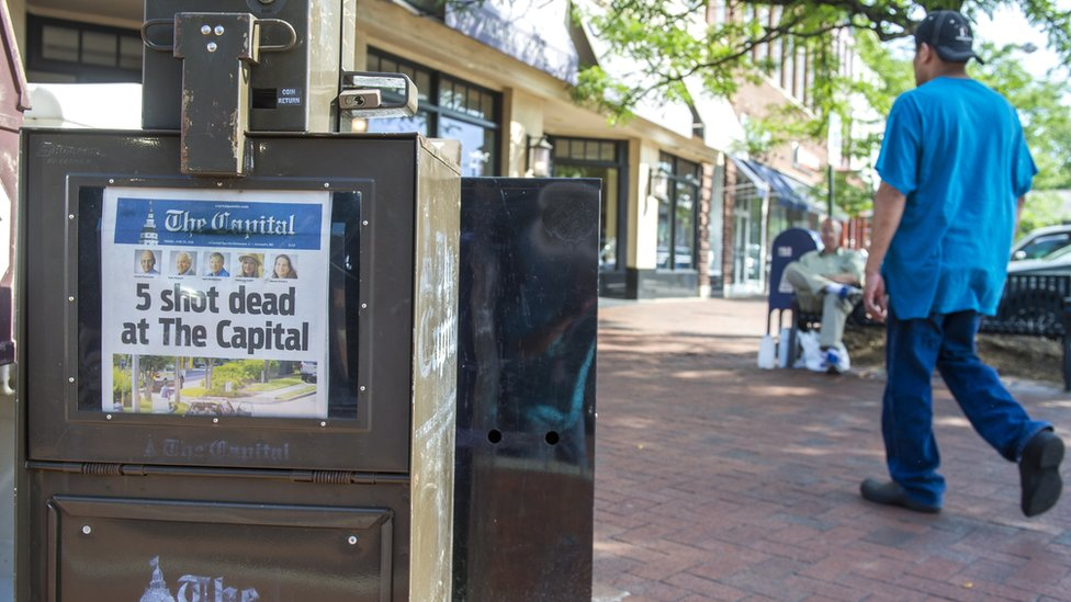 the Capital Gazette newspaper on sale the day after the shooting