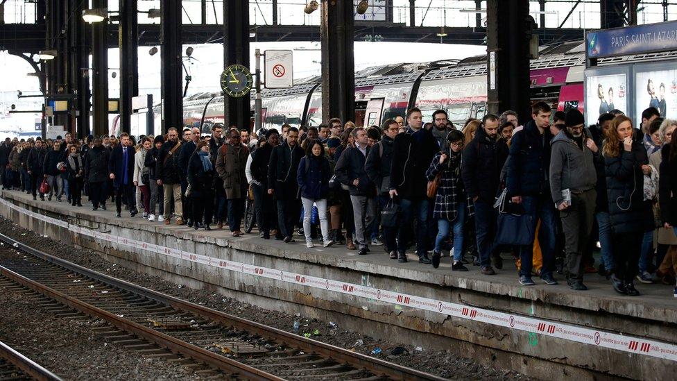 Passengers on the platform of a Parisian train station