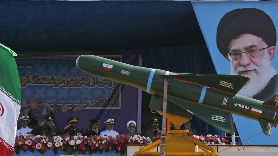 An Iranian military lorry carries missiles past a portrait of Iran's Supreme Leader Ayatollah Ali Khamenei during a parade on 18 April 2018 in Tehran