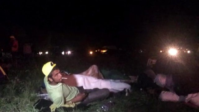 Migrants lying by the road