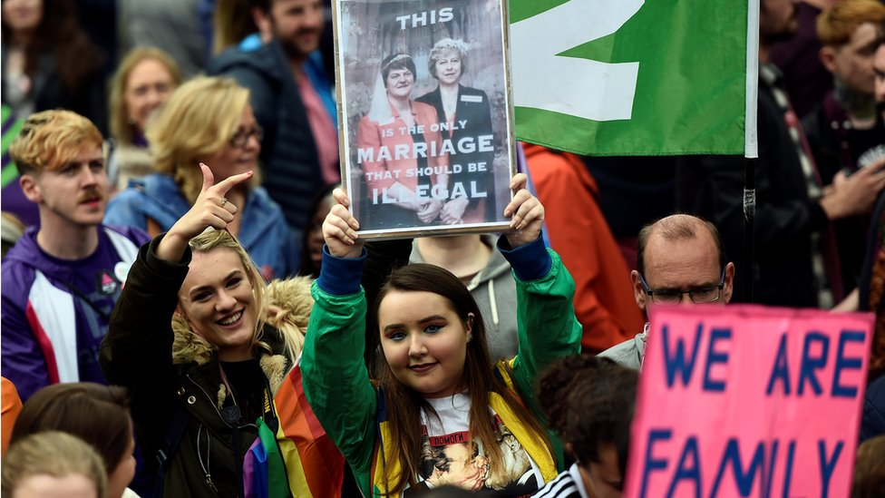 Some demonstrators held placards protesting about the DUP - which opposes same-sex marriage - and its deal with the Conservatives