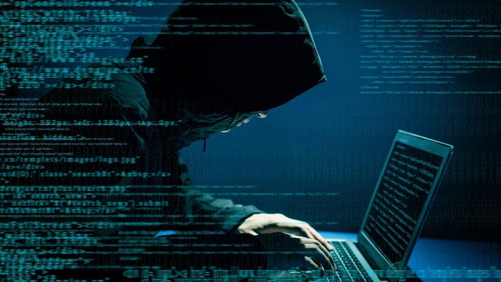 A hacker on a computer