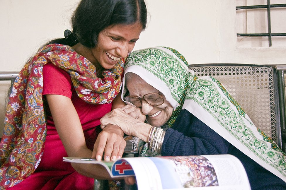 An older lady and her carer in India