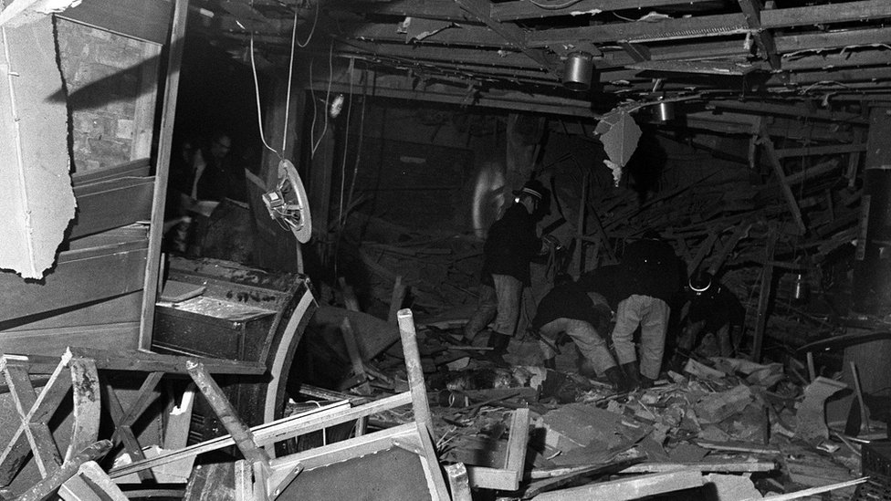 Firemen searching through debris in the heart of Birmingham after a bombing outrage in which two pubs were bombed