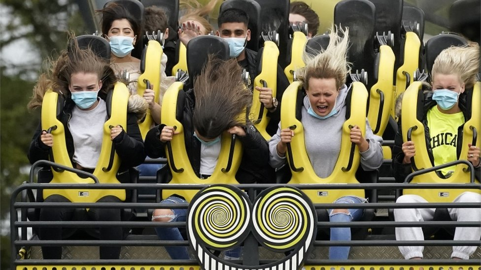 """Members of the public wear face masks as they ride """"The Smiler"""" rollercoaster at Alton Towers on July 4, 2020 in Alton, England."""