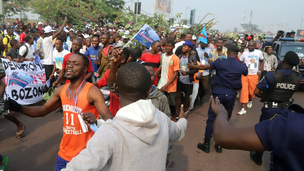 """Supporters of Congolese opposition leader Jean-Pierre Bemba chant slogans outside the N""""djili International Airport as he arrives in Kinshasa, Democratic Republic of Congo August 1, 2018."""