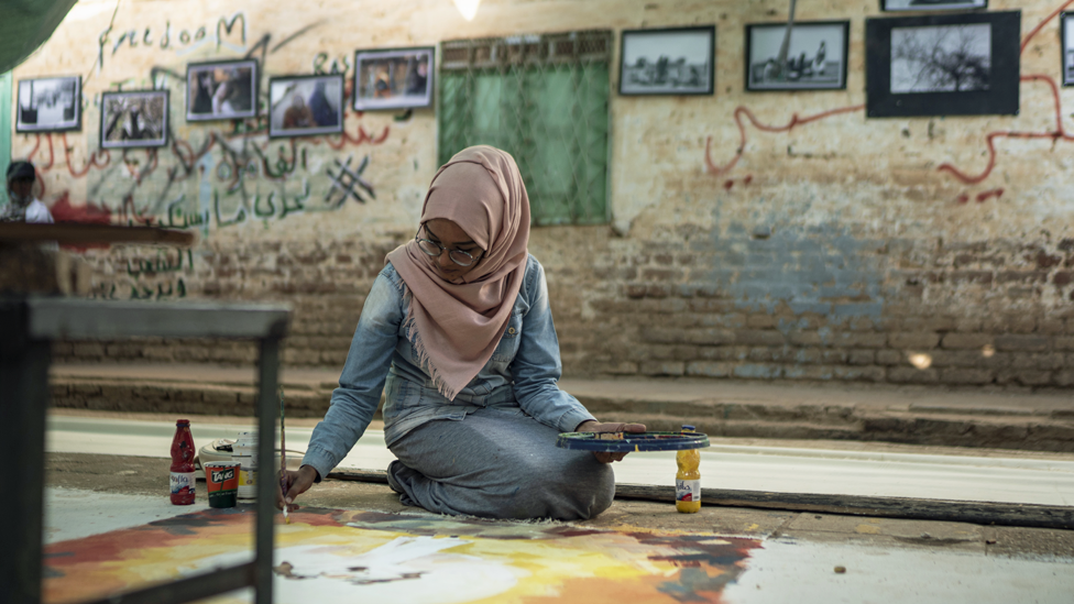 An artist working on a canvas roll at the vocational traing centre in Khartoum, Sudan