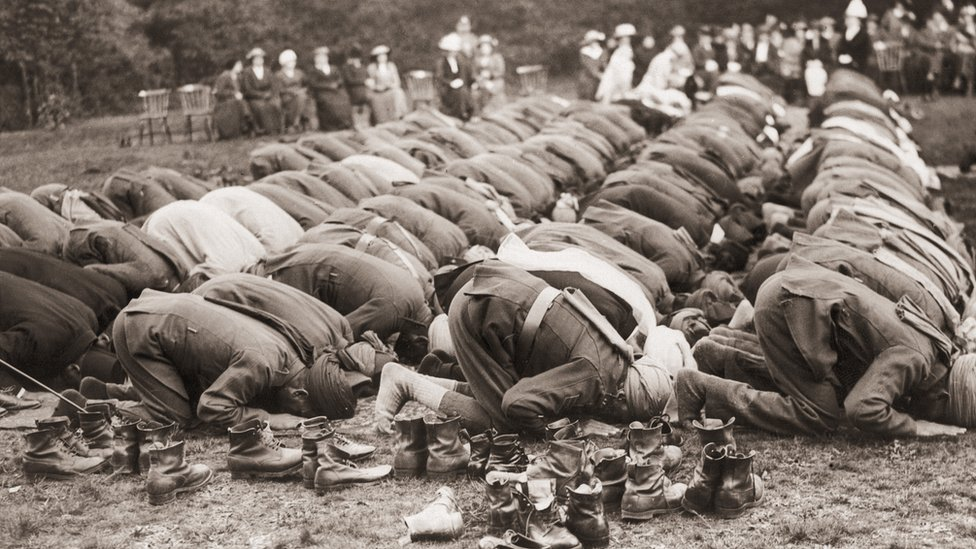 Indian troops serving with the British Army pray outside the Shah Jahan Mosque in Woking, Surrey.