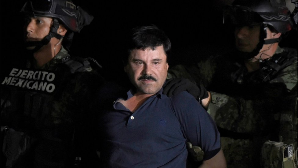 "Drug kingpin Joaquin ""El Chapo"" Guzman is escorted into a helicopter at Mexico City""s airport following his recapture during an intense military operation in Los Mochis, in Sinaloa State"