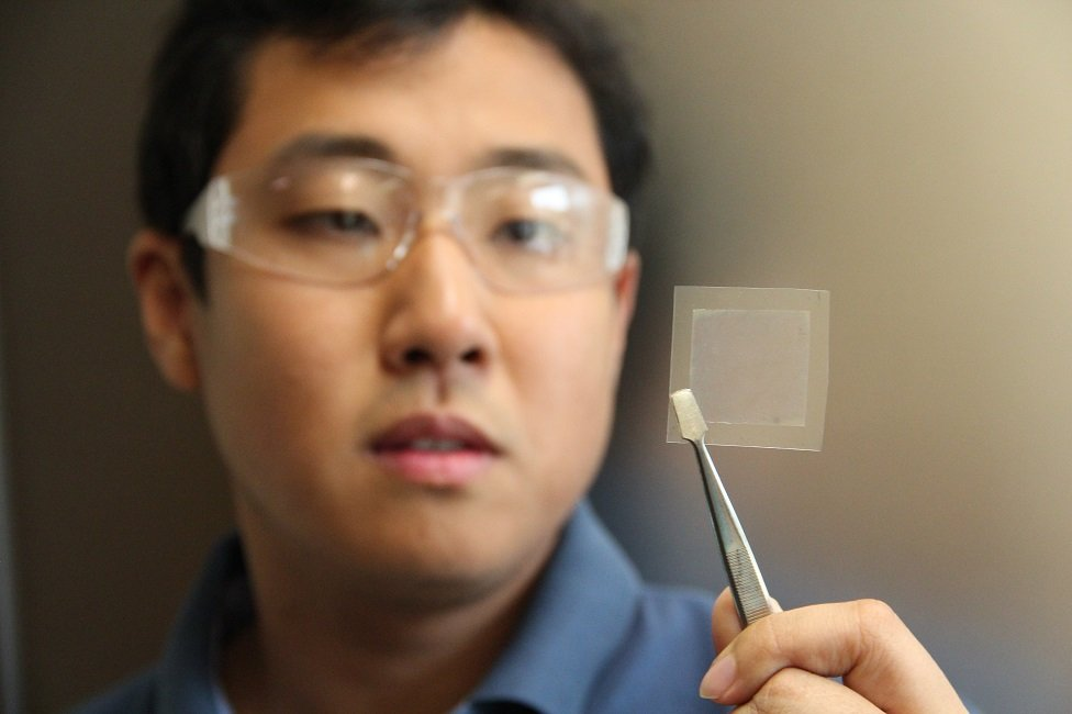 Dr Dong Han Seo, from Australia's CSIRO, holds a piece of graphene film