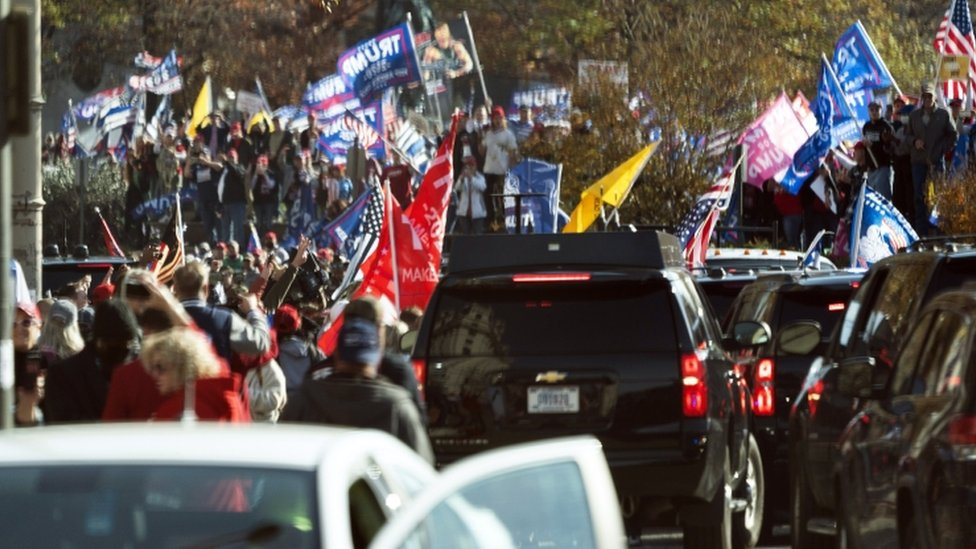 Trump supporters demonstrate as the motorcade carrying President Donald J. Trump drives through a rally of while departing the White House, headed out to an undisclosed location in Washington, DC, USA,