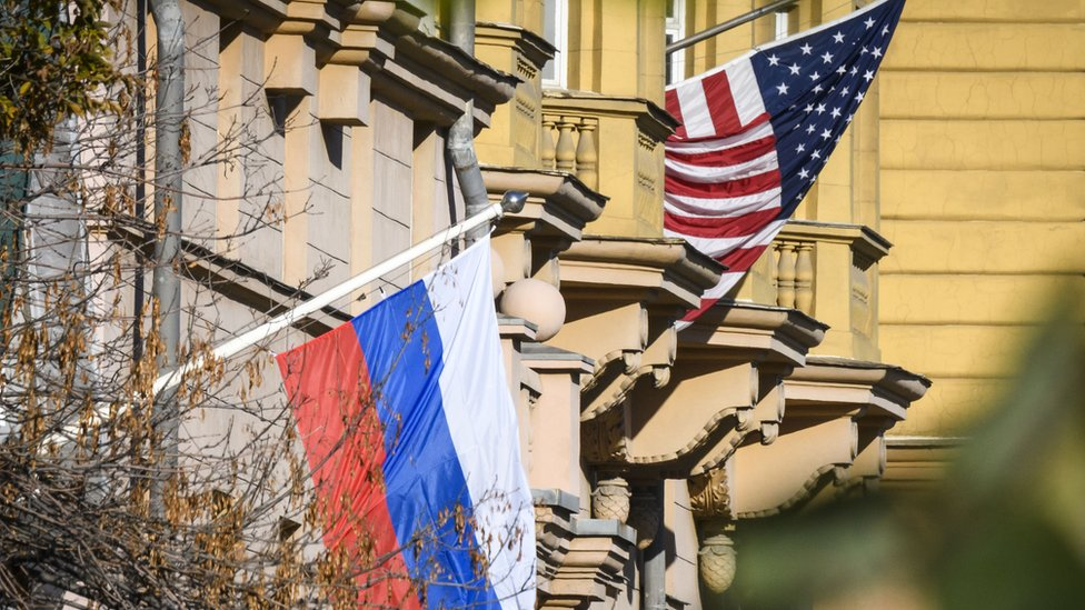 US and Russian flags side-by-side
