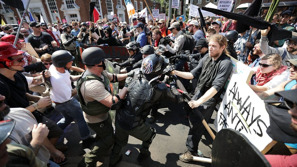 "White nationalists, neo-Nazis and members of the ""alt-right"" clash with counter-protesters in Charlottesville on 12 August, 2017"
