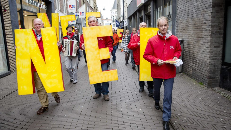 Dutch Socialist Party member Harry van Bommel hands out flyers for the No-campaign