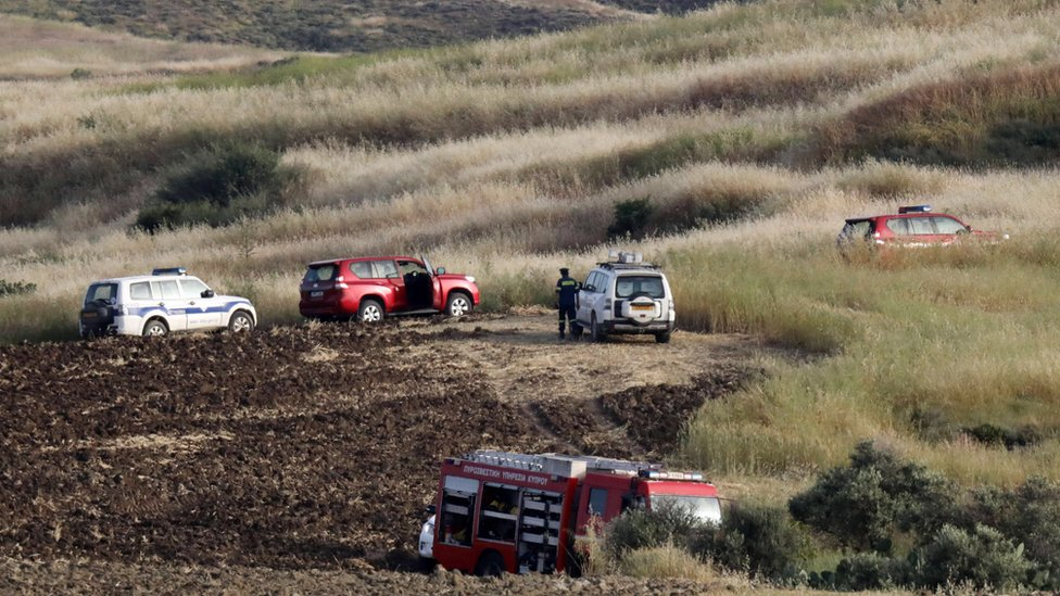 Police and rescue vehicles have been investigating the grassy, hilly area where one of the bodies was found, near the village of Orounta in Cyprus