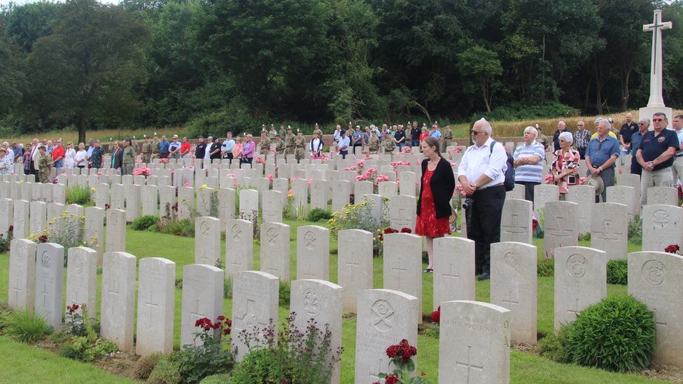 People pay their respects to the Welsh soldiers who fell at Mametz Wood in Flatiron Copse cemetery