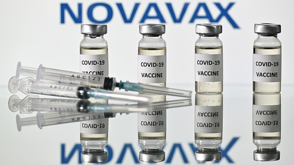 Image shows vials of Novavax Covid-19 vaccine and syringes