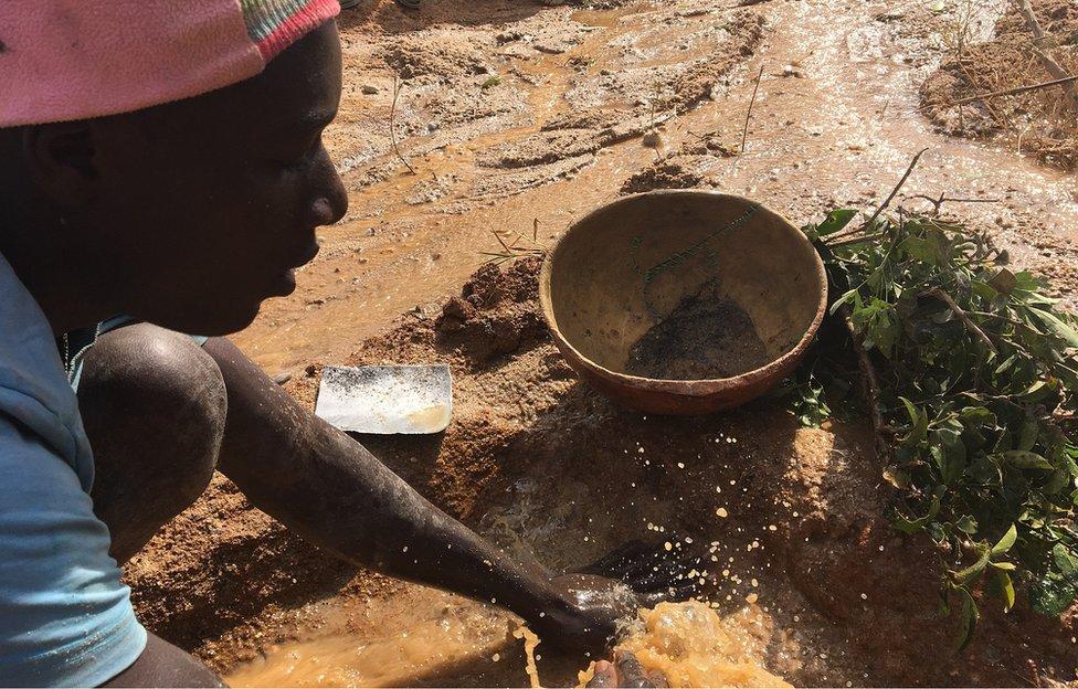 A man panning for tin