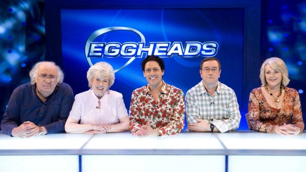 CJ de Mooi, centre, on the set of Eggheads