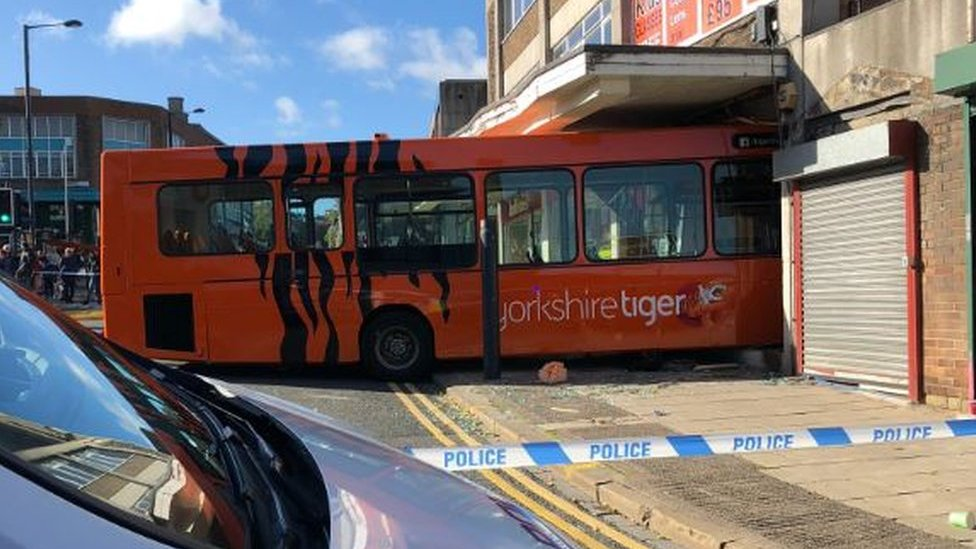 Yorkshire Tiger bus crashes into Shipley opticians