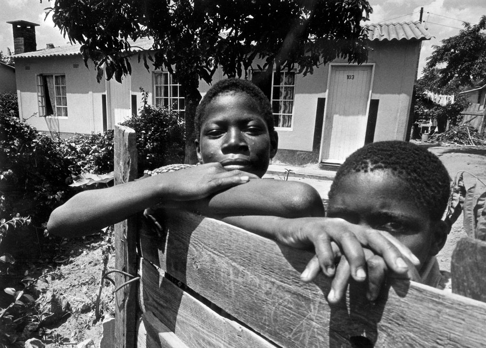 Young Rhodesian boys pose behind a fence in January 1977 in Salisbury, Rhodesia and formerly the capital of Zimbabwe. The Rhodesian government and the black nationalists face a long guerilla which led to an agreement and a multiracial new Assembly in 1978. In 1980, British government proclaimed the independence of South Rhodesia, becoming Zimbabwe. Robert Mugabe is appointed Prime minister.