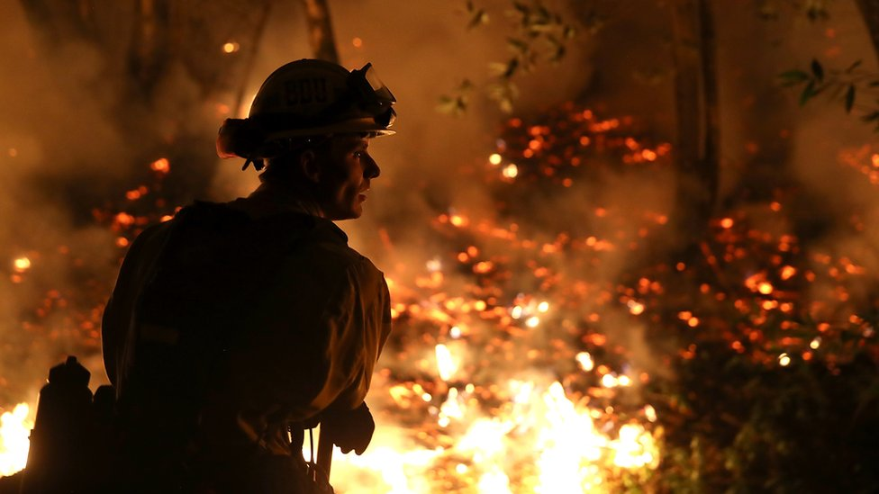 A firefighter tackles the flames in northern California's wildfires