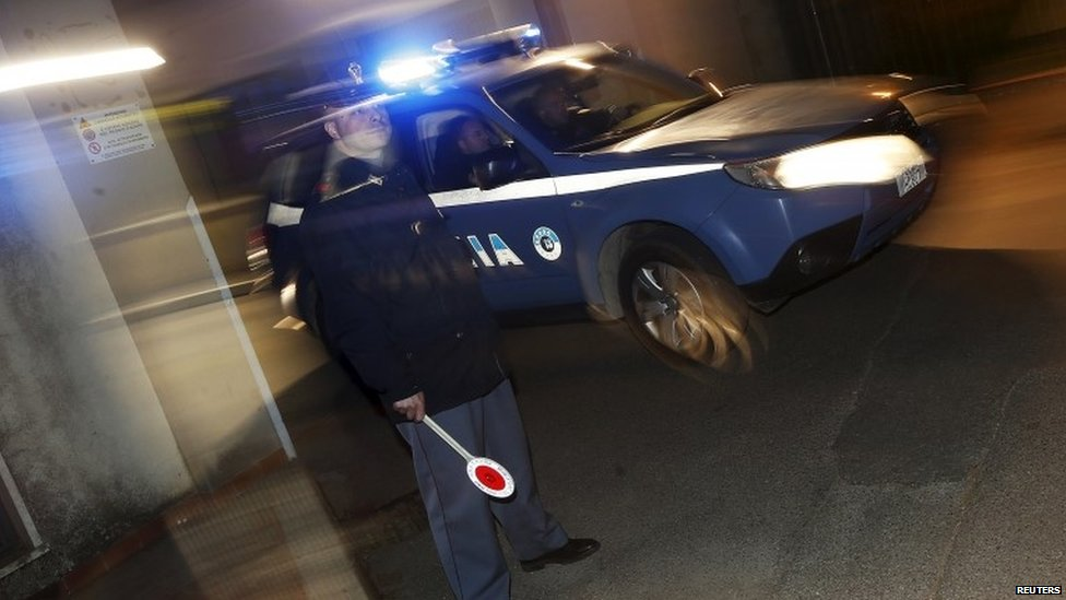 An Italian police car leaves a police station near Catanzaro, Italy May 7, 2015