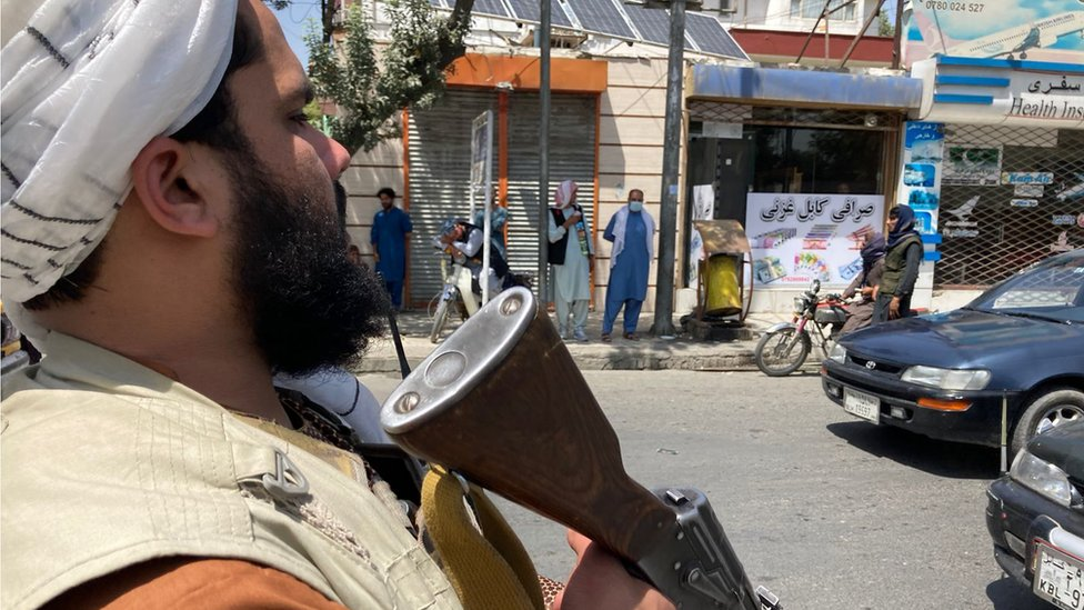 A Taliban fighter directing traffic in Kabul