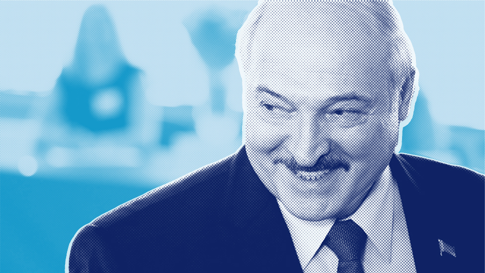 Lukashenko smiling after casting his vote in the election.