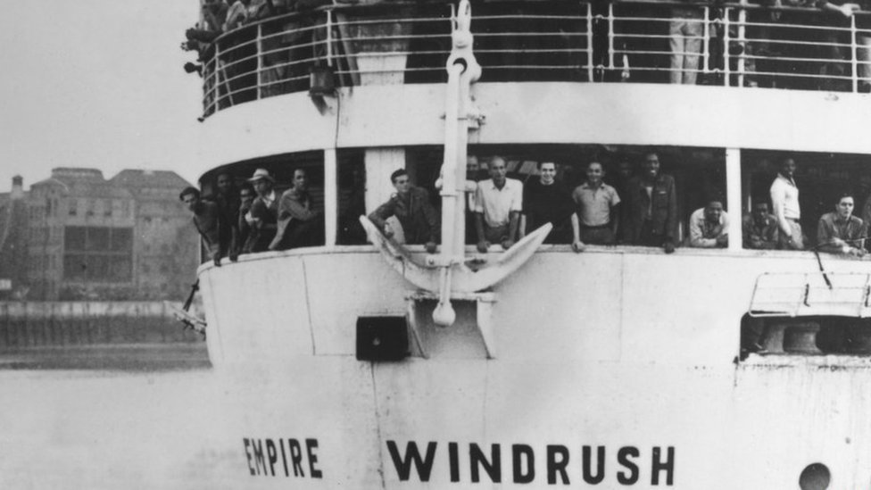 """The ex-troopship """"Empire Windrush"""" arriving at Tilbury Docks from Jamaica, with 482 Jamaicans on board, emigrating to Britain"""