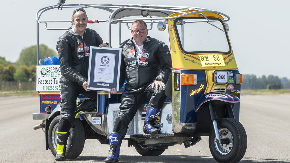 Essex businessman Matt Everard (right) and passenger Russell Shearman celebrate their Guinness World Record after setting the world land speed record in a tuk tuk at Elvington Airfield