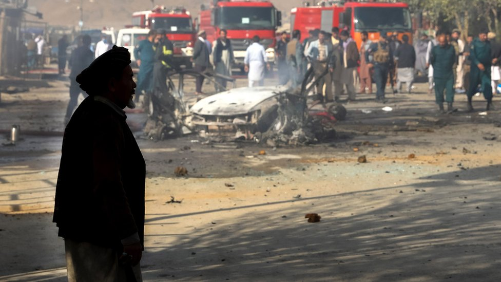 An Afghan man stands near the scene of blast in Kabul, Afghanistan, 27 October 2020.
