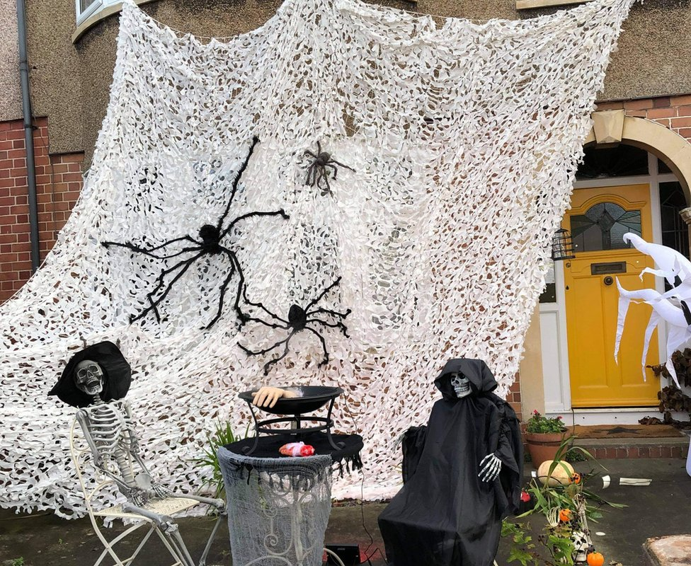 Maria Wolf's Bristol Halloween display featuring a huge spider web