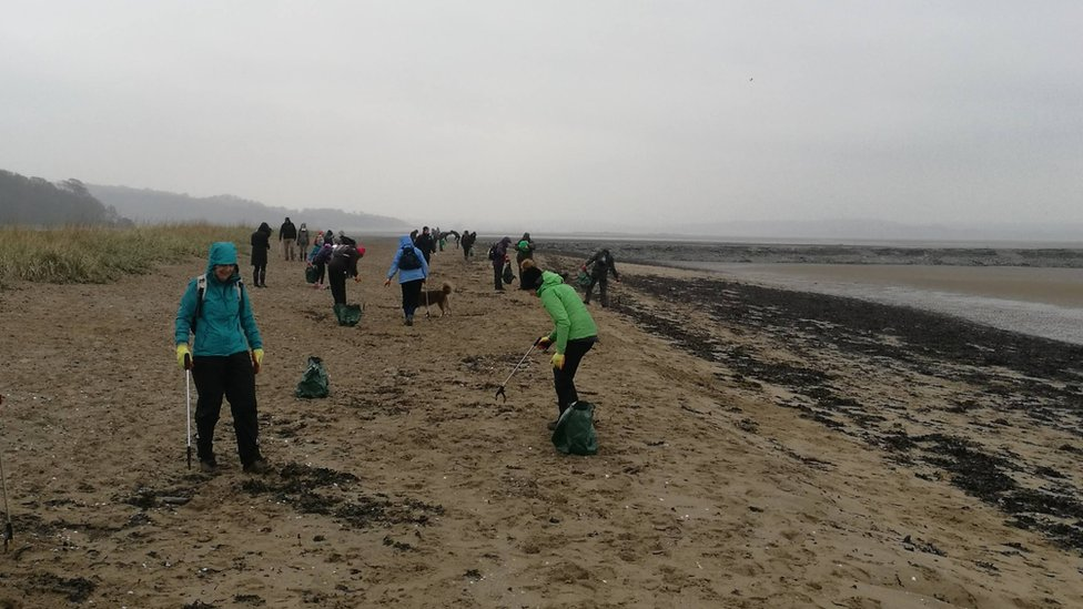 Beach cleaners at Cramond