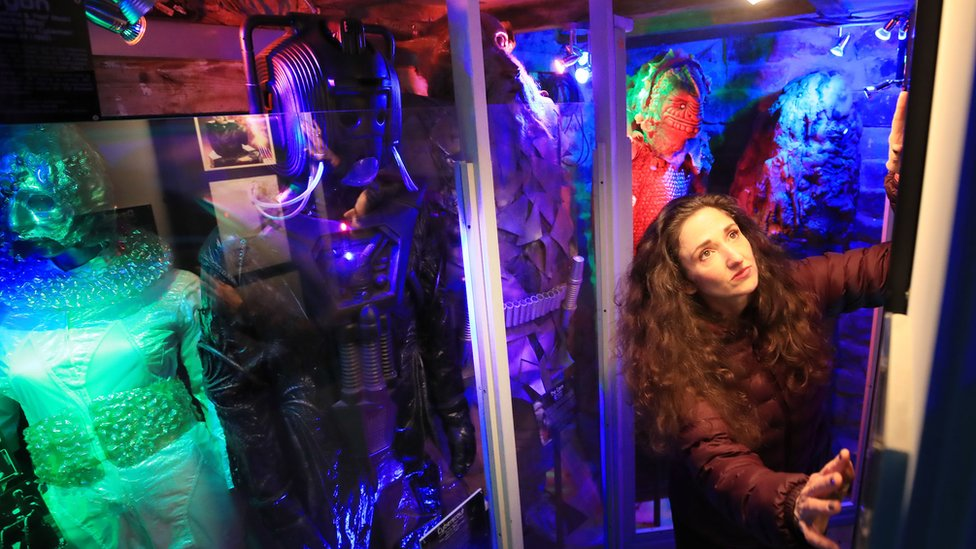 Lisa Cole alongside a Cyberman costume in the couple's cellar
