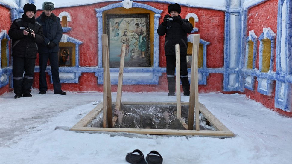 An inmate takes a dip at a high-security penal colony in Omsk, Russia