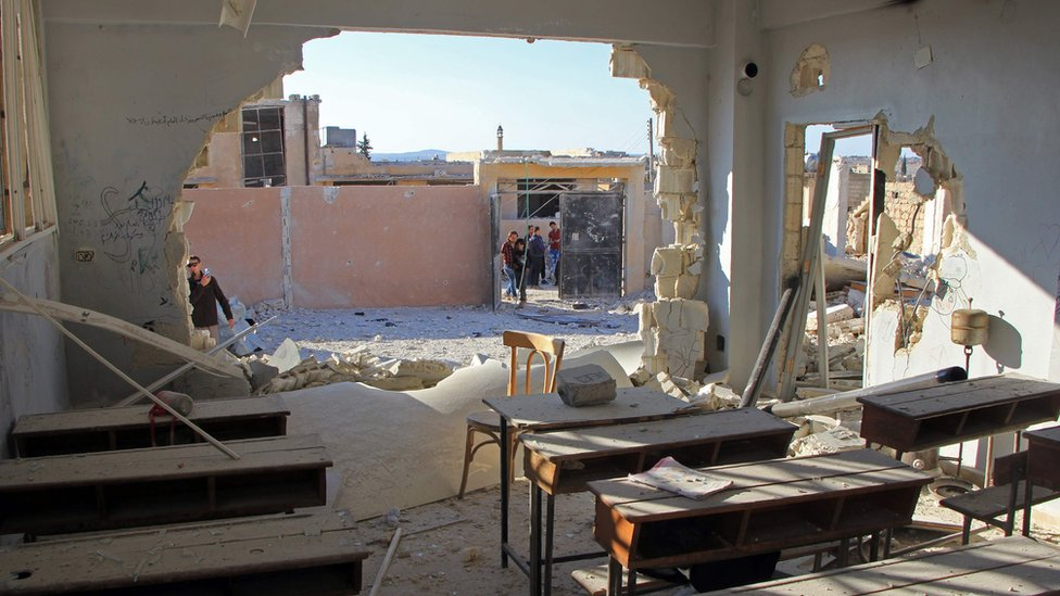 Damaged classroom at a school hit in a reported air strike in the village of Hass, Idlib province (26 October 2016)