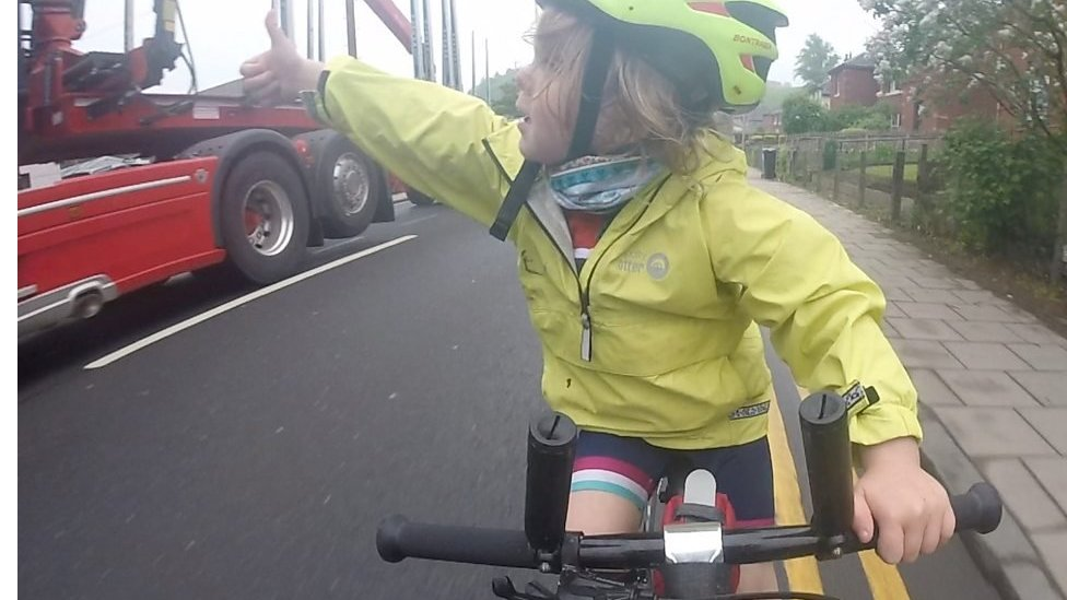 Cyclist, 4, gives lorry driver thumbs up for 'perfect pass'