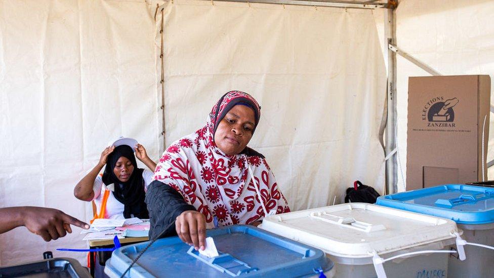 Woman voting at polling station in Zanzibar
