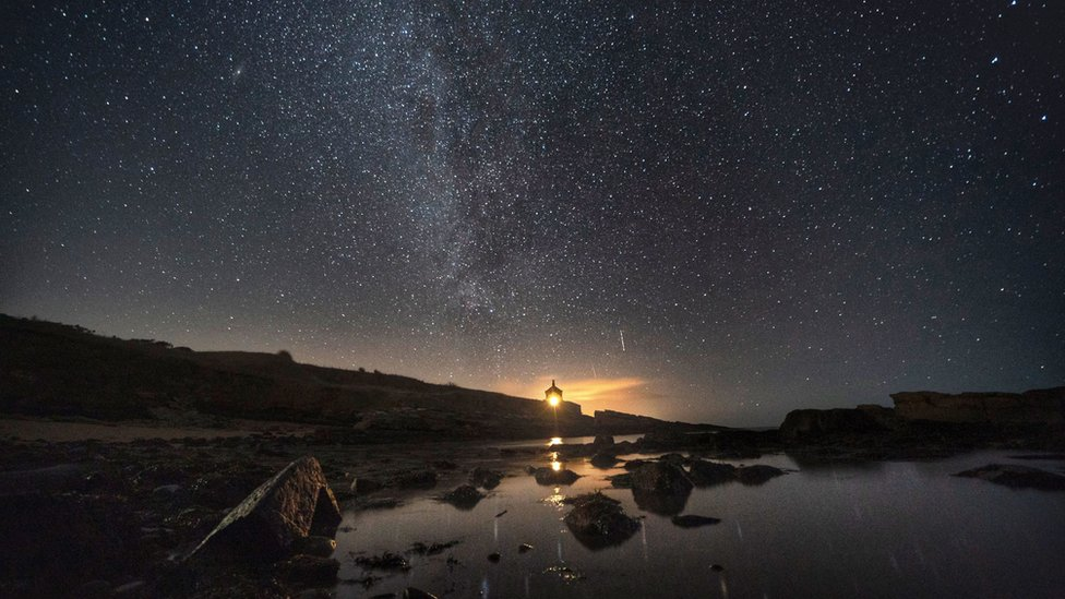 The Milky Way - the galaxy that contains our Solar System - seen above the Bathing House in Howick, Northumberland