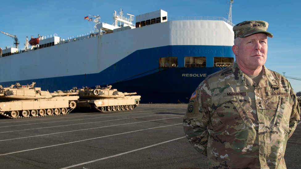 "Timothy McGuire, Major General and Deputy Commanding General United States Army Europe, stands in front of US Army tanks and the cargo vessel ""Resolve"" in Bremerhaven, northern Germany"