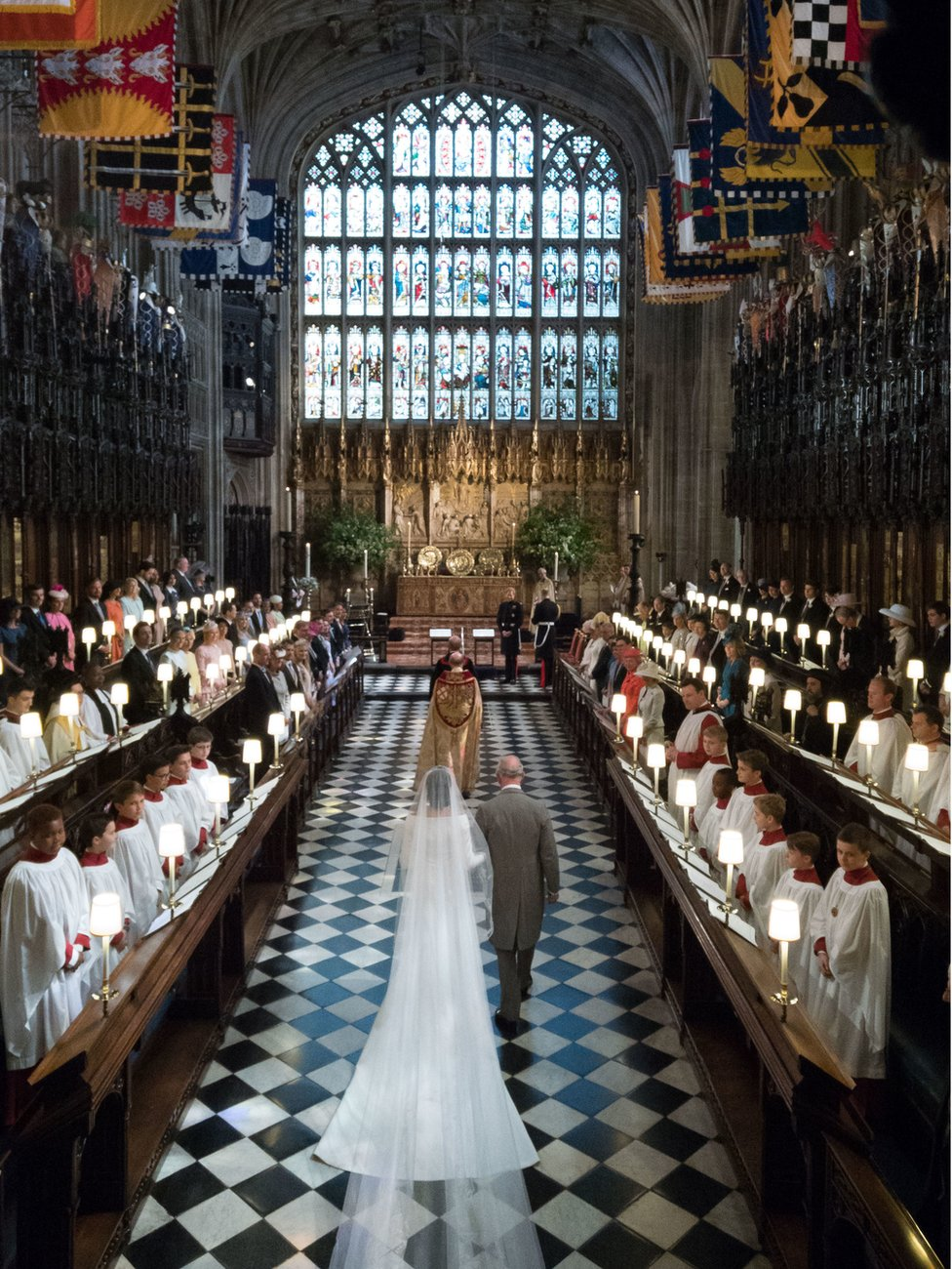 """Meghan Markle walks up the aisle with the Prince of Wales at St George""""s Chapel at Windsor Castle"""