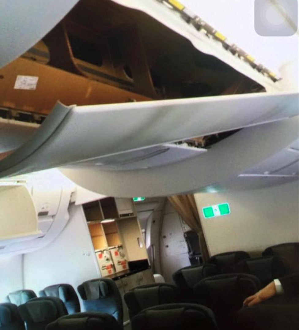 Ceiling panel torn from Cathay Pacific Airbus