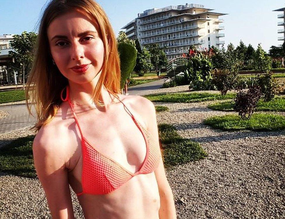 Anastasia poses in a bikini