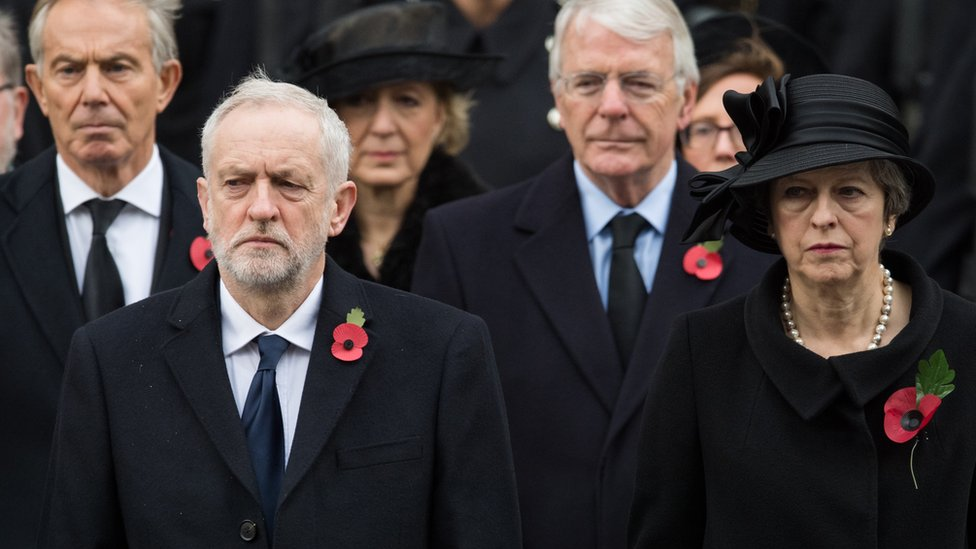 Prime Minister Theresa May, Opposition Leader Jeremy Corbyn and former prime ministers Tony Blair and John Major wear the red poppy on Remembrance Sunday last year