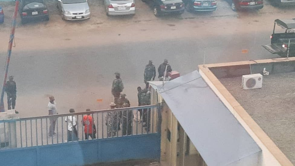 Soldiers by the gate of the Daily Trust newspaper in Abuja, Nigeria