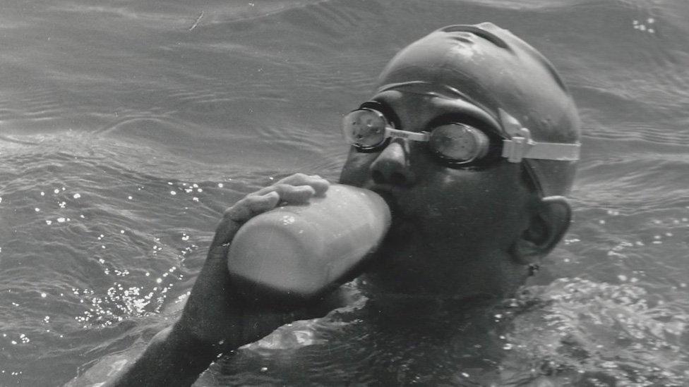 Tom Gregory swigging from a water bottle