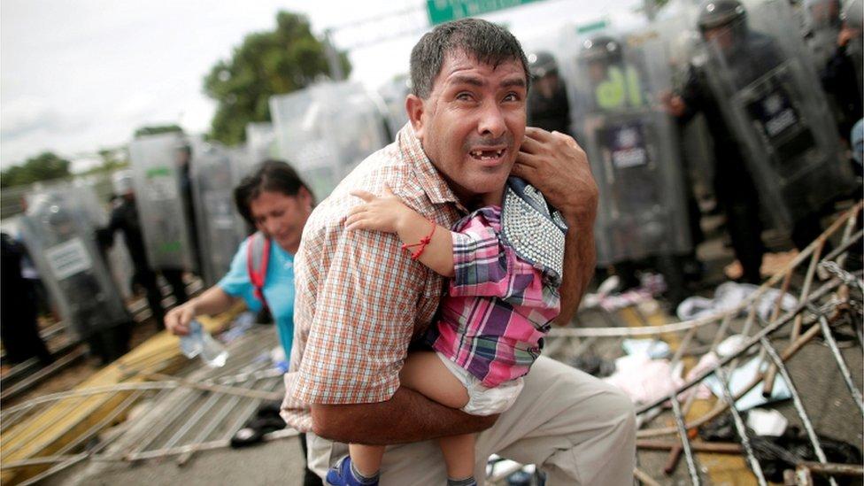 Migrant caravan: US-bound migrants clash with Mexico riot police