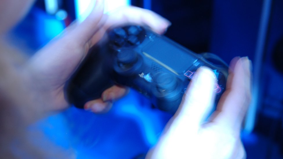 Close up hands on games controller